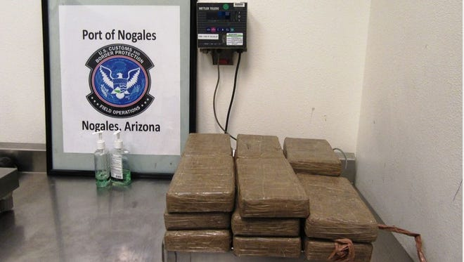 Forty-one pounds of cocaine was found at the Nogales crossing in the vehicle of a mother traveling with three children, officials said.