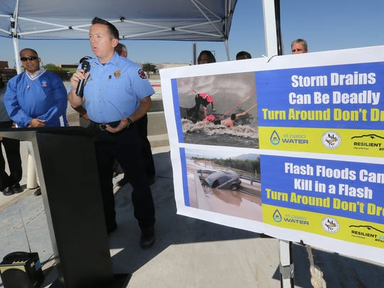 El Paso Fire Dept. Capt. Kristian Menendez offers tips about water safety during a press conference to announce the Turn Around, Don't Drown Stormwater Safety Campaign at the new Magnolia Pump Station on Monday. Wayne Thornton of the Drowning Prevention Coalition is at left.