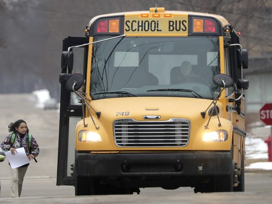 A Kaukauna student is dropped off on the city's south side following early release from school on Monday. Schools were preparing for an ice storm that hit the region Monday afternoon and is expected to last through much of Tuesday.