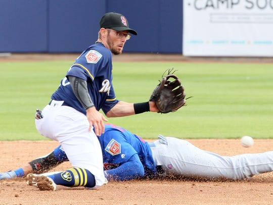 Bewers second baseman Eric Sogard waits for a late