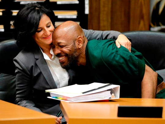 Eric Kelley, right, is hugged by his lawyer Vanessa Potkin moments after Passaic County Superior Court Judge Joseph Portelli granted Kelley a retrial during a hearing in Paterson, N.J.