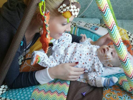 Bethany Rein plays with her son, Charlie.