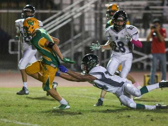 Coachella Valley receiver Angelo Fitzgerald breaks
