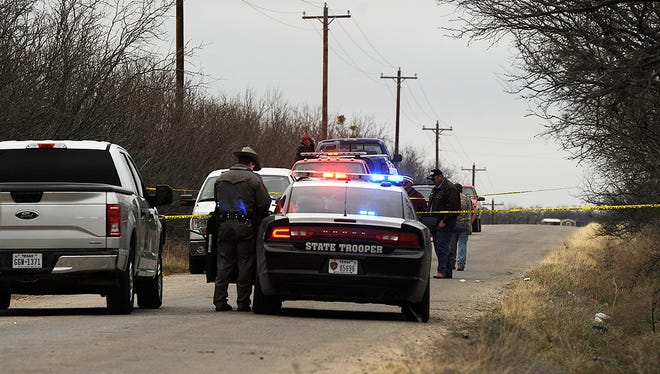 Texas DPS troopers and Jones County Sheriff's deputies investigate a shooting on Jones County Road 341 on Saturday, March 4, 2017.