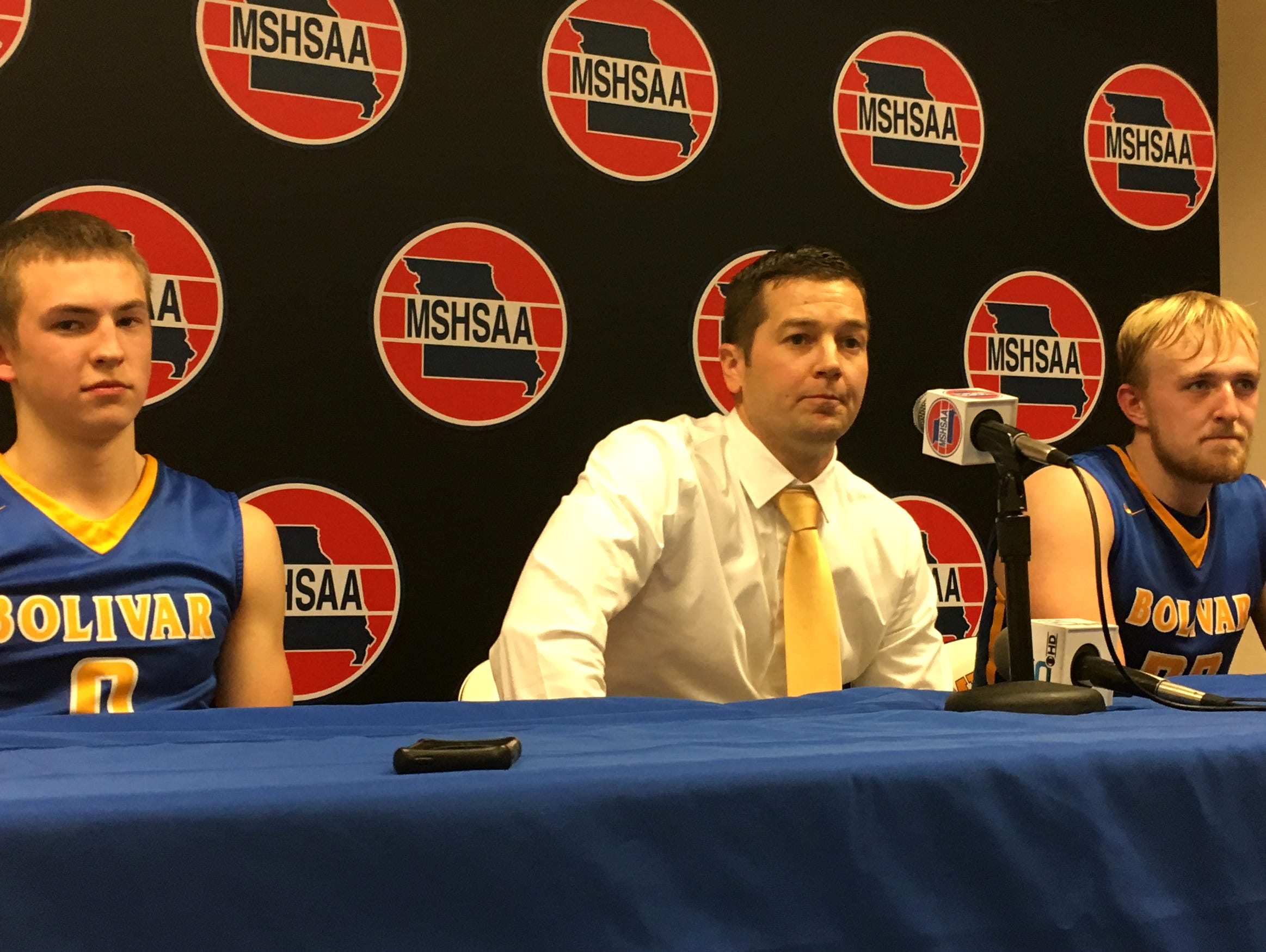 From left, Bolivar guard Conley Garrison, coach Robby Hoegh and forward Brandon Emmert address reporters following the Liberators' 63-41 Class 4 boys basketball semifinal win at Mizzou Arena in Columbia March 16, 2017.