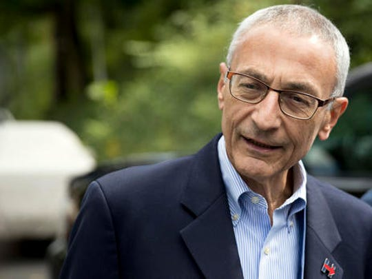 In this Oct. 5 photo, Hillary Clinton campaign chairman John Podesta speaks to members of the media outside Clinton's home in Washington. The WikiLeaks organization on Oct. 7, posted what it said were thousands of emails from Podesta, including some with excerpts from speeches she gave to Wall Street executives and others — speeches she has declined to release despite demands from Trump.