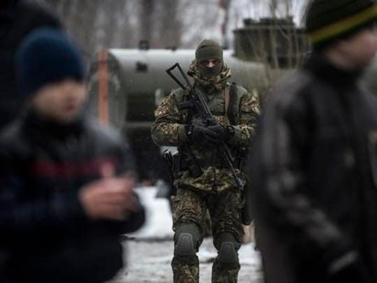A Ukrainian serviceman patrols at the humanitarian aid center in Avdiivka, Ukraine, Saturday, Feb. 4, 2017. Fighting in eastern Ukraine sharply escalated this week. Ukraine's military said several soldiers were killed over the past day in shelling in eastern Ukraine, where fighting has escalated over the past week.