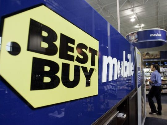 An employee walks near the Best Buy Mobile section
