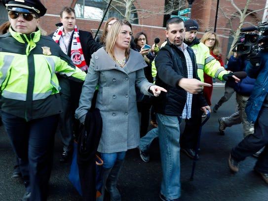 Boston Marathon bombing victim Marc Fucarile, right,
