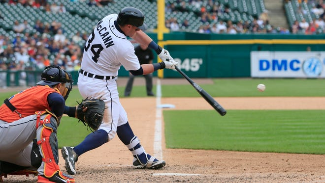 Detroit Tigers' James McCann connects for the game-winning home run during the 11th inning of a baseball game against the Houston Astros, Thursday, May 21, 2015, in Detroit. The Tigers defeated the Astros 6-5.