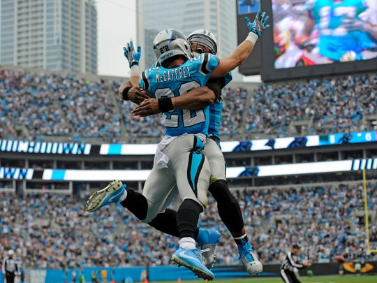 Carolina Panthers' Christian McCaffrey (22) celebrates with Cam Newton after his touchdown run against the Atlanta Falcons in the first half of an NFL football game in Charlotte, N.C., Sunday, Nov. 5, 2017. (AP Photo/Mike McCarn)