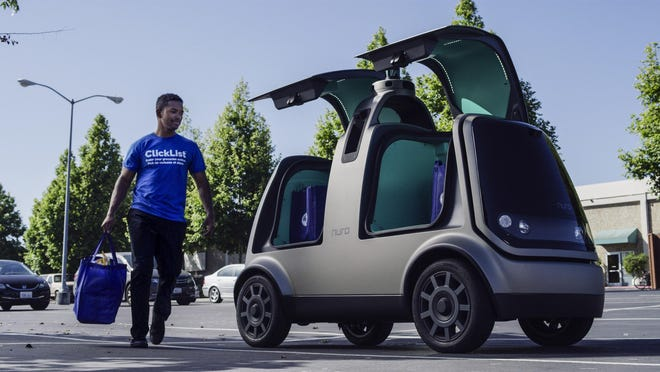 Nuro and Kroger said Tuesday, Dec. 18, 2018, that Nuro's unmanned vehicle, the R1, will be added to a fleet of autonomous Prius vehicles that have run self-driving grocery delivery service in Scottsdale, Ariz., with vehicle operators since August.