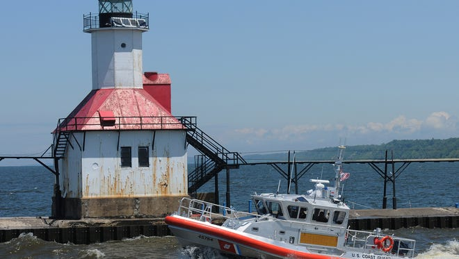 A U.S. Coast Guard crew, based in St. Joseph, Mich., travels past the St. Joseph Lighthouse en route to Lake Michigan.