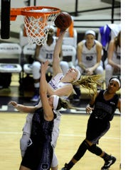 Abilene Christian's Breanna  Wright (10) gets fouled by Central Arkansas' Maggie Proffitt (22) during the third quarter of the Wildcats' 83-76 win on Saturday, Jan. 7, 2016, at ACU's Moody Coliseum.