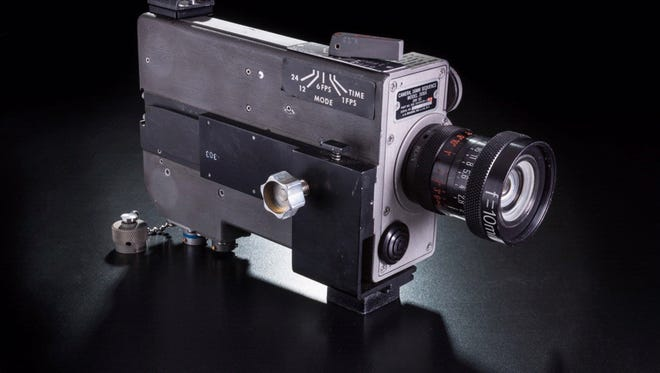 The 16mm movie camera that filmed Neil Armstrong's first steps on the moon were among 20 pieces of lunar landing hardware he kept hidden for more than 40 years in a closet of his home outside Cincinnati. His wife found the bag after his death in August 2012.