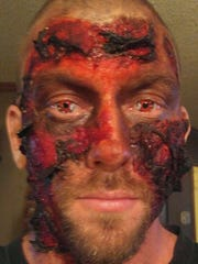 David Tidwell poses in burnt zombie makeup for Fear