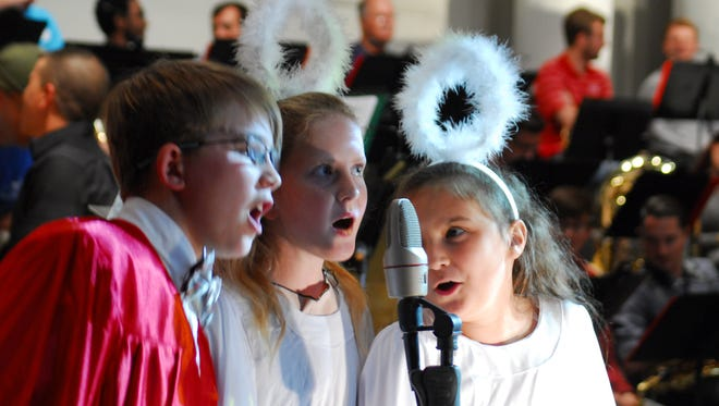 """Knox Villemarette and the angels of the children's choir sing a number in """"I'll Be Home For Christmas,"""" a production being presented by First Baptist Church of Lafayette."""