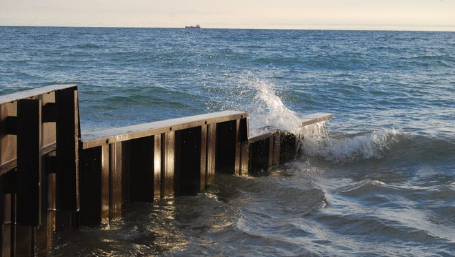 Waves smash into a seawall in Fort Gratiot. A small craft advisory remains in effect for Lake Huron until 4 a.m. Friday.Boaters can expect sustained winds up to22 knots with gusts up to 25 knots.