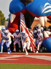 The Coleman Bluecats take the field prior to Friday's