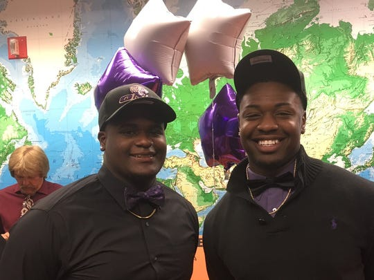 Lely High School's Marco Celus, left, and Andy Duprat celebrate signing with NAIA Olivet Nazarene University in a ceremony at the school on April 12.