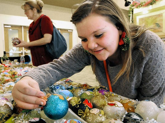 Audrey Harmeson looks at handmade ornaments at Mr. Magoo's Closet on during the La Casa Bazaar at the Las Cruces Convention Center in 2014.