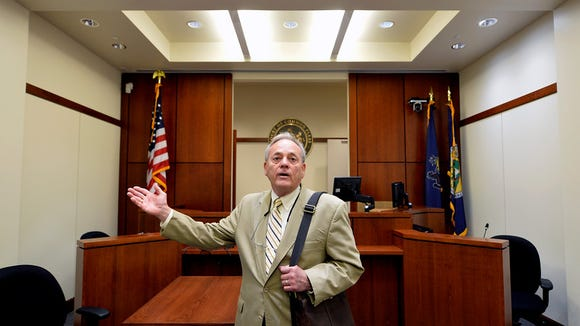 York County President Judge Stephen P. Linebaugh discusses the difference in size between several of the newly-built courtrooms during a tour of the recently finished fifth floor of the York County Judicial Center on Wednesday, June 24, 2015. When the seven-story judicial center was finished in 2004, the fifth floor was purposely left vacant to allow for additional courtrooms and chambers to be built at a later time. President Judge Stephen P. Linebaugh said it was anticipated that those facilities would be needed to accommodate increased caseloads by 2015. The completed fifth floor, which was estimated to be a $7.1 million project but came out about $6.9 million, has eight smaller, non-jury courtrooms, multi-purpose rooms and two judges' chambers. Chris Dunn -- Daily Record/Sunday News