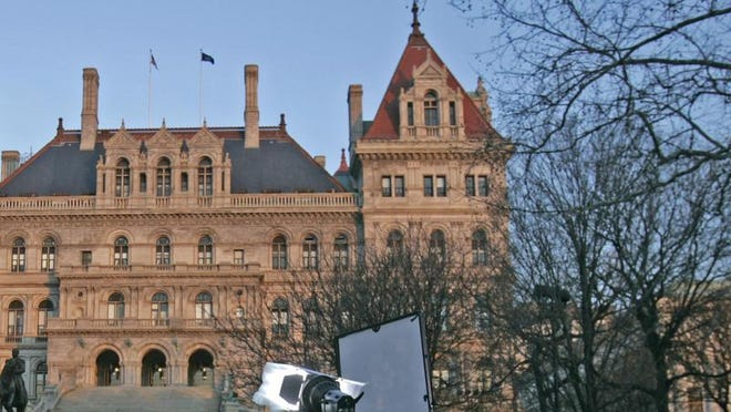 Televisions lights and cameras are positioned in front of the state Capitol in Albany, N.Y., Tuesday, March 11, 2008. Gov. Eliot Spitzer apologized on Monday after he was accused of involvement in a prostitution ring. He did not elaborate on the scandal, which drew calls for his resignation. (AP Photo/Mike Groll)