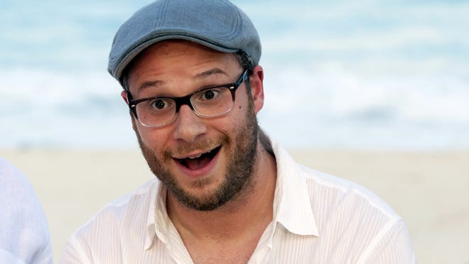 """This April 21, 2013 file photo shows Seth Rogen posing on a beach promoting the film """"This is The End"""", in Cancun, Mexico. (AP Photo/Alexandre Meneghini, File)"""