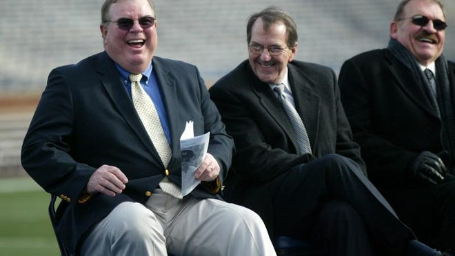 Longtime analyst Jim Brandstatter, left, will take over radio play-by-play duties for the Wolverines this season, while former U-M standout Dan Dierdorf, sitting to the right of former U-M coach Lloyd Carr, is the new analyst. The two were teammates in the late 1960s and early 1970s.