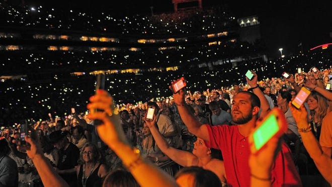 Fans hold their phones in the air at LP Field at the 2013 CMA Music Festival. Sometimes it's best to leave your phone in your pocket.