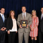 The Fort Collins La-Z-Boy store was recently recognized as No. 4 among top-performing La-Z-Boy stores. From left, account executive Nate DiOrio, Fort Collins lead designer Sabrina Knowles, Fort Collins store owner Jason Johnston, senior account executive Halle Carroll, and La-Z-Boy, Inc., Vice President Jim Reilly.