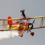 Gene Soucy and Teresa Stoke amaze the crowd with their Showcat Wingwalk at the 2014 EAA Airventure Airshow on July 31.
