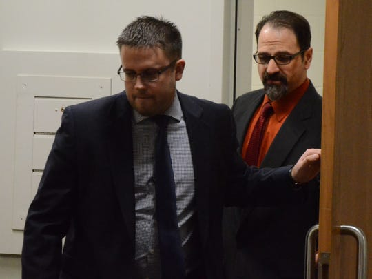 Attorney Josh Blanchard leads Troy Estree into the