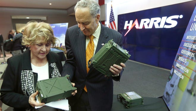 Senator Chuck Schumer and Rep. Louise Slaughter look at radios after a press conference at Harris Corporation where they announced major push to secure new federal investment opportunities.