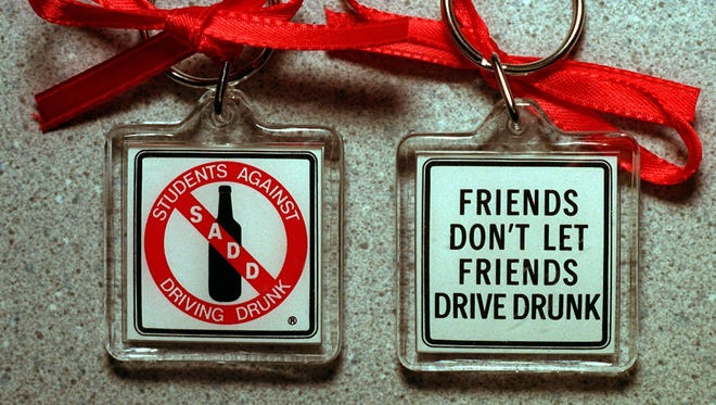 Key chains with red ribbons to remind people not to drink and drive.