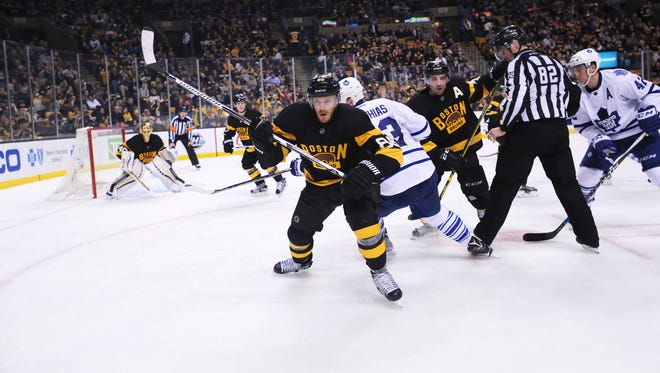 Boston Bruins defenseman Kevan Miller (86) chases a loose puck in the corner during the third period against the Toronto Maple Leafs at TD Garden.
