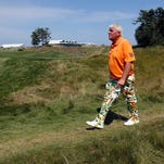 John Daly walks to the 10th hole during the second round of the PGA Championship golf tournament Friday, Aug. 14, 2015, at Whistling Straits in Haven, Wis. (AP Photo/Julio Cortez)