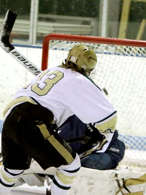Hunter Hirzel watches the puck go over the shoulder of Stoney Creek goalkeeper Carson Redshaw for a goal Friday night. Hirzel finished with two goals in Howell's 6-3 win.