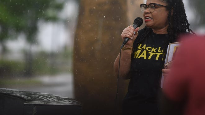 Sonya Patrick of Wilmington's arm of the Black Lives Matter movement speaks during a protest to show support for George Floyd at the 1898 Memorial Park in downtown Wilmington. In the wake of nationwide protests sparked by Floyd's death at the hands of a police officer, Patrick's group and others are calling for a citizen's review board to conduct oversight of police actions.