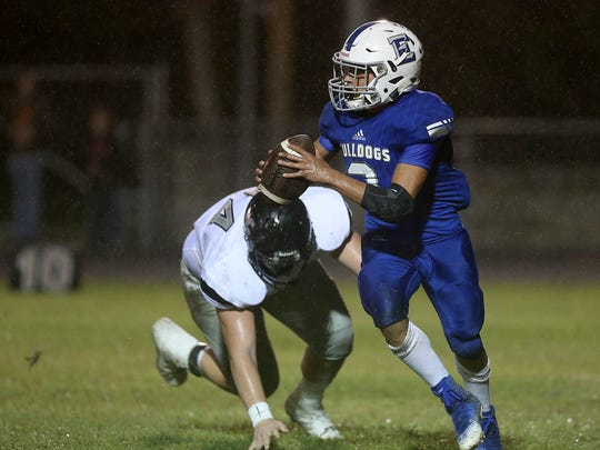 Eden Bulldog Donovan Gonzales escapes the grasp of a Water Valley Wildcat during Friday night's game in Eden Sept. 29, 2017.