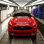 The very first 2015 Ford Mustang GT production sports car sits at the end of the assembly line inside the Flat Rock Assembly Plant in Flat Rock.