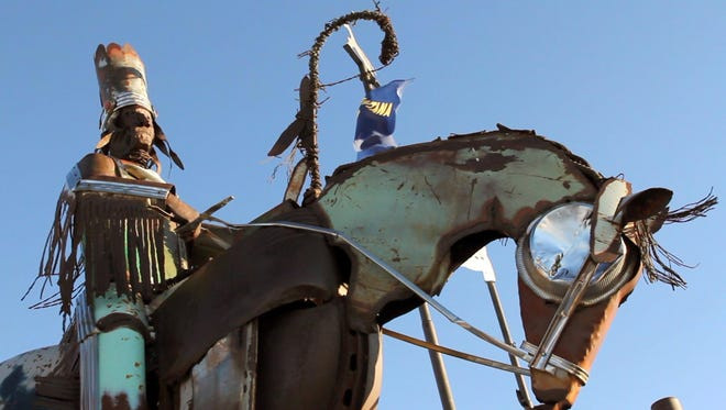 Salvaged metal sculptures depicting two warriors on horseback greet visitors to the Blackfeet Nation south of Browning, Mont.