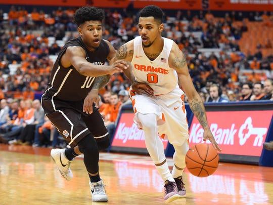 Syracuse forward Michael Gbinije (0) drives to the