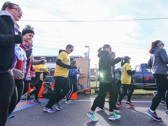 Thousands of people take off from the starting line during the fifth atTAcK Addiction 5K run Saturday, Mar 03, 2018, at St. Peter's Church in New Castle, DE
