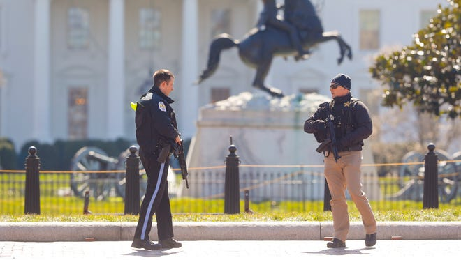 Law enforcement officers at Lafayette Park across from the White House in Washington, close the area to pedestrian traffic, Saturday, March 3, 2018. A man apparently shot himself along the north fence of the White House midday, according to the Secret Service, which also said he was being treated for the wound.