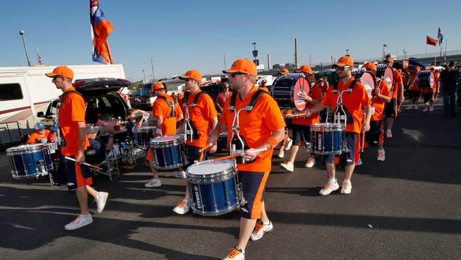 The Denver Broncos Stampede marching band arrives prior to a game against the San Francisco 49ers on Oct. 19, 2014, in Denver.