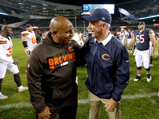 Cleveland Browns head coach Hue Jackson and Chicago Bears head coach John Fox greet each other after an NFL preseason football game, Thursday, Aug. 31, 2017, in Chicago. The Browns won 25-0. (AP Photo/Charles Rex Arbogast)