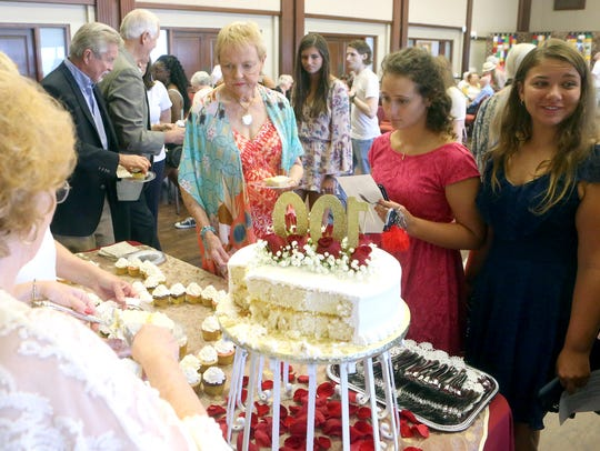 Friends and family of Ruby Hiatt line up to get cake