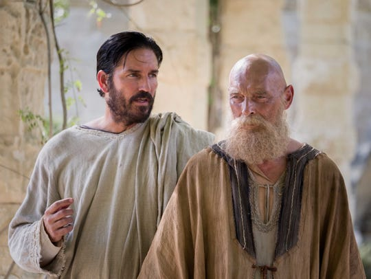 Luke (Jim Caviezel) and Paul (James Faulkner) confer