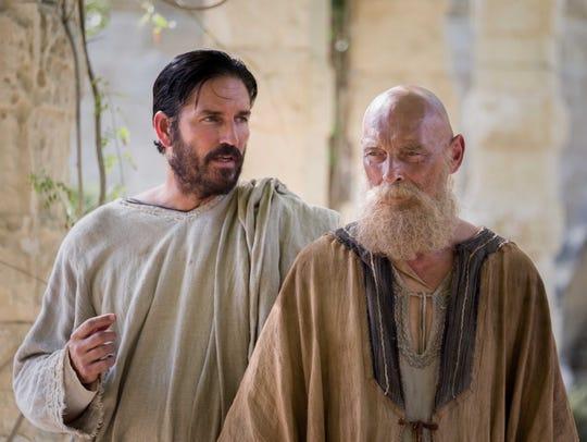 Luke (Jim Caviezel) and Paul (James Faulkner) confer